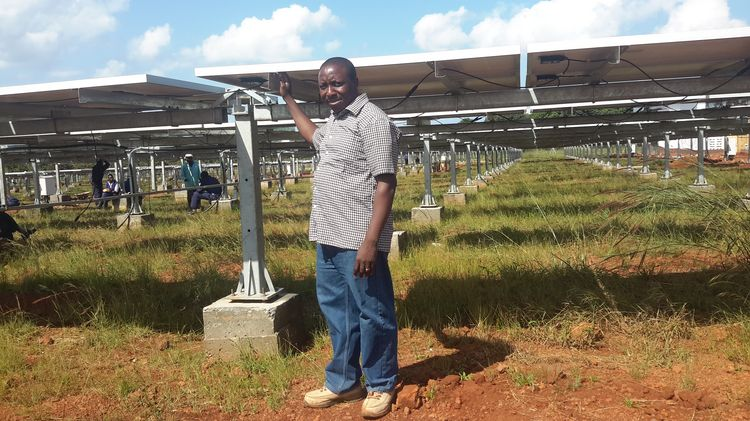 Jagwe Wycliff on site checking PV modules